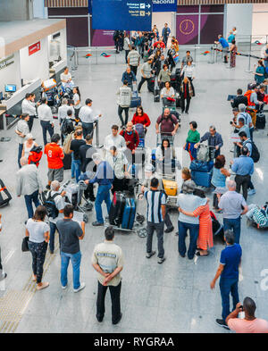 Rio de Janeiro, Brazil - March 13, 2019: Travelers, families and taxi drivers at international arrivals hall at Galeao Rio de Janeiro International - Stock Image