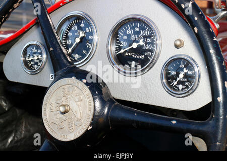 Instrument panel with speedometer in the cockpit of a vintage race car. - Stock Image