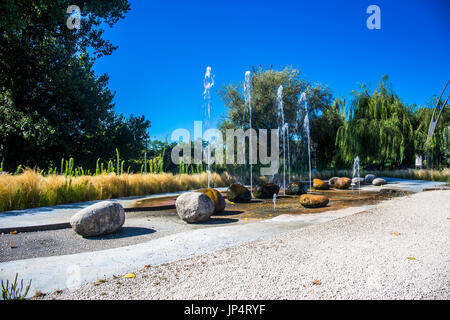 Decorative fountain in the park. - Stock Image