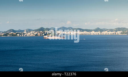 Container ship in import export and business logistic, captured at Guanabara Bay, Rio de Janeiro, Brazil. - Stock Image