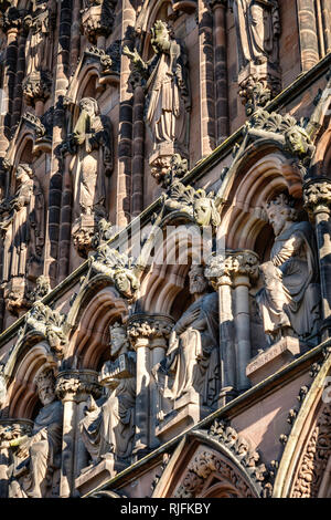 There are over 160 ornate carved figures of kings, queens and saints around Lichfield Cathedral. - Stock Image