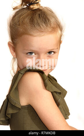 A six year old girl smiling at the camera - Stock Image