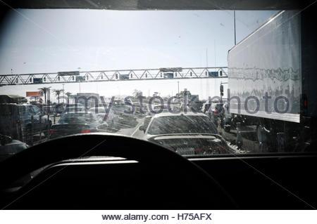 View thru windshield of queue for the Oakland/San Francisco Bay Bridge crossing, heading towards San Francisco. - Stock Image