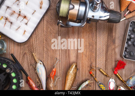 Accesories for fishing on wooden background with copyspace . - Stock Image