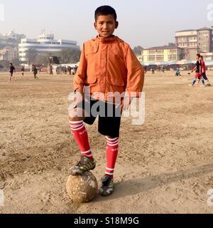 Boy with football, Kathmandu - Stock Image