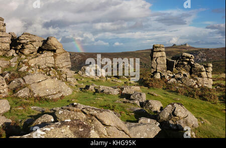 View from Hound Tor to Haytor in Dartmoor National Park with rainbow - Stock Image
