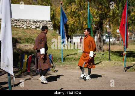 Opponents face each other before a round in a traditional archery match in Paro, Bhutan - Stock Image
