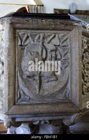 14th century font. North face depicting the Lamb of God. St Michael's Church, Irstead, Norfolk - Stock Image