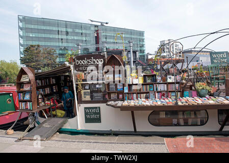 word on the water, the London Book Barge, bookshop on Regent's Canal Kings Cross London England Britain UK - Stock Image