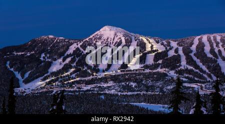 Night Skiing runs light up on Mount Washington ski resort as dusk settles on the popular Vancouver Island ski resort., The Comox Valley, Vancouver Isl - Stock Image