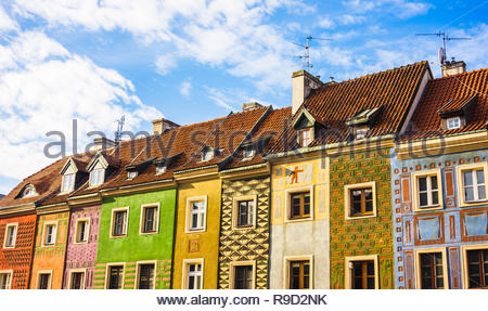 Poznan, Poland - November 12, 2018: Row of colorful houses with roof on the old city square.  - Stock Image