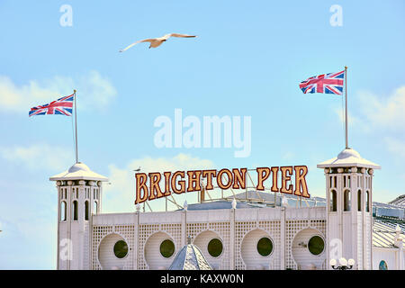 Detail of Brighton Pier entrance, with Union Jacks flying. - Stock Image