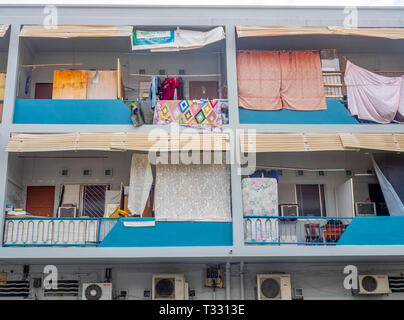 Balconies with hanging washing in high rise apartments in Joo Chiat Singapore. - Stock Image