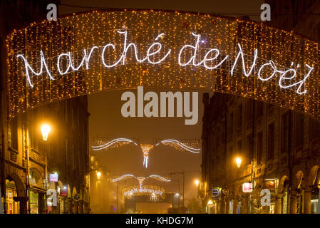 Illuminated sign advertising an outdoor Christmas market in Arras, France - Stock Image