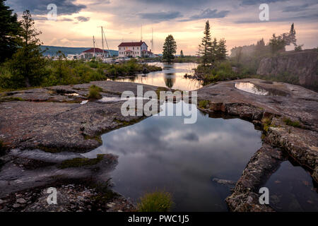 Clouds at sunset on the shore of Lake Superior at Grand Marais. - Stock Image