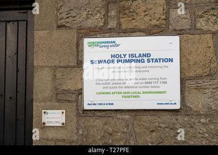 Lindisfarne or Holy Island, Northumberland coast south of Berwick-on-Tweed, England. Water pumping station sign. - Stock Image