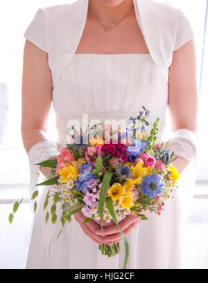 Bride,bridal gown,bridal bouquet,standing,wedding day,wedding,groom,marriage,marriage promises,forever,most beautiful,Hand,Hands - Stock Image