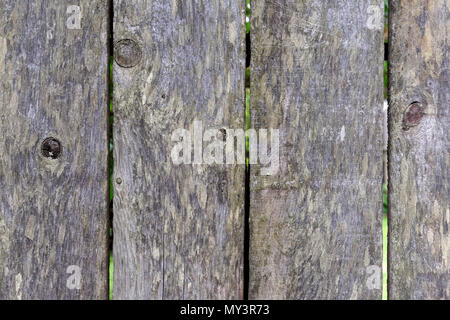 Weathered unpainted wooden fence background - Stock Image