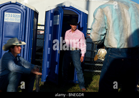 Cowboy members of PRCA at rodeo event in Bridgeport, Texas, USA - Stock Image