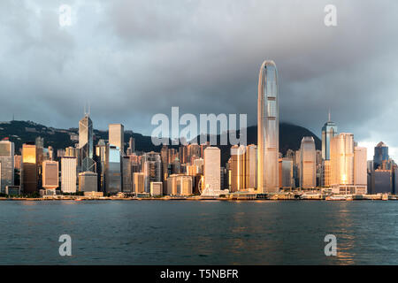 Hong Kong skyline with sunlight in the morning over Victoria Harbour in Hong Kong. - Stock Image