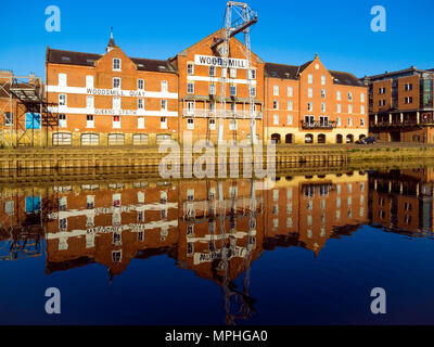 Historic buildings on Woodsmill Quay Queen's Staithe reflected in morning light in the River Ouse in York City Centre - Stock Image