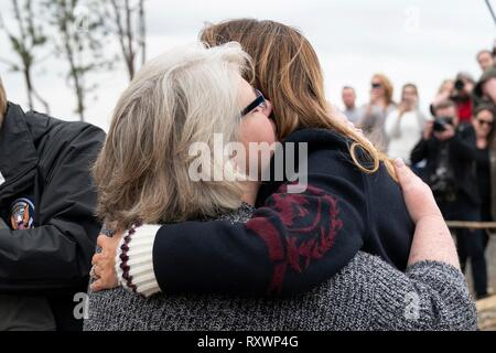 U.S First Lady Melania Trump comforts a victim of a massive tornado March 8, 2019 in Lee County, Alabama. The region was hit by a tornado on March 3rd killing 23 people. - Stock Image