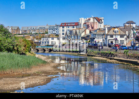 6 July 2018: Bude, Cornwall, UK - Homes and businesses in the seaside town, reflected in the River Neet, on a hot summer day. - Stock Image