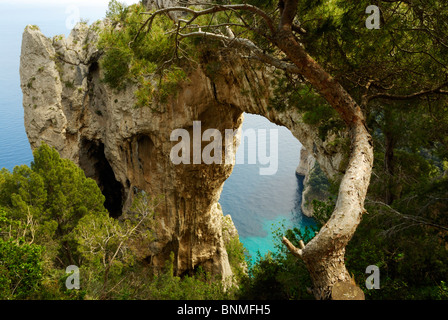 Looking down through the Arco Naturale to the sea on Capri, Italy. - Stock Image