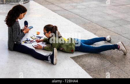 Two young Spanish teenage girl studying together - Stock Image