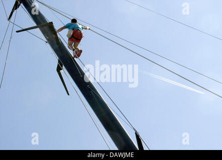 A member of the China Team works in the rig during the Flight 5 race of the Louis Vuitton Cup' Round Robin 2, - Stock Image