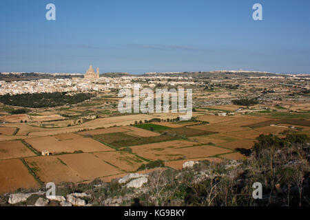 Looking north across a rural valley towards the village of Xewkija in Gozo, Malta. Gozitan landscape. - Stock Image