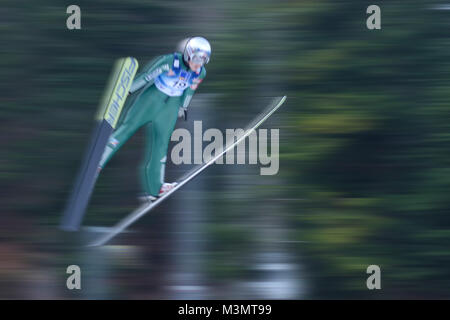 Ski jumper soars with speed in motion blur trough the air. Jumping Hill Ljubno ob Savinji, Slovenia. 27. januar - Stock Image