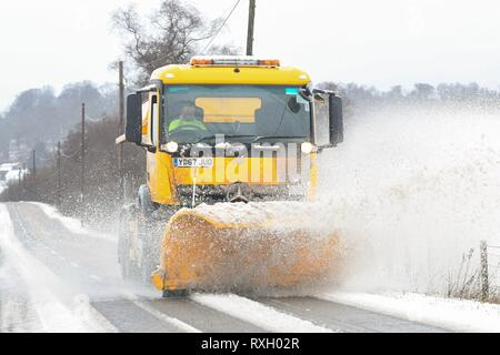 Aberfoyle, Stirlingshire, Scotland, UK - 10 March 2019: uk weather - snowplough clearing the A81 road near Aberfoyle, Stirlingshire, Scotland Credit: Kay Roxby/Alamy Live News - Stock Image
