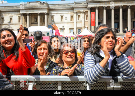 Trafalgar Square, London, UK, 08th June 2019. Spectators on the square. Thousands of Londoners and visitors come together on Trafalgar Square to celebrate the end of Ramadan and Eid Festival, as well as London's rich cultural diversity. The festival is hosted by Mayor of London Sadiq Khan. - Stock Image