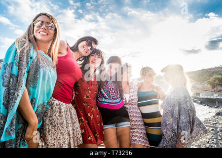 People friends group of young cheerful women smiling and having fun together  outdoor in summer holiday vacation leisure activity - caucasian females  - Stock Image