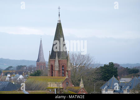 spires sitting high above rooftops in the worthing west sussex skyline - Stock Image