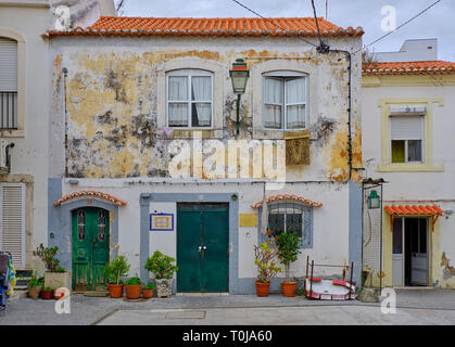 Typical portuguese village house facade. Example of architecture and urbanism of the countryside. - Stock Image
