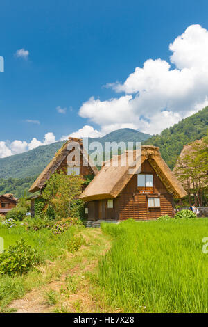 Old houses of unique gassho style with thatched roof in Ogimachi village of Shirakawa-go district. World Heritage - Stock Image