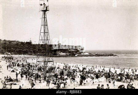 Coogee Bay Beach with Shark Tower (for observation), Sydney, New South Wales, Australia, with hot sea bathing and massage rooms. - Stock Image