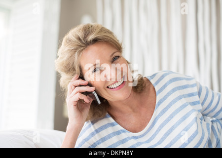 Older woman talking on cell phone - Stock Image