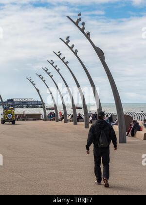 Blackpool, England, UK - August 1, 2015: A man walks on the promenade at Blackpool. - Stock Image