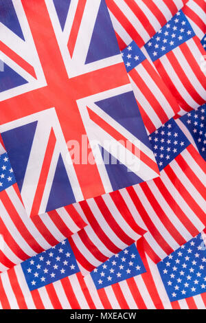 Union Jack and Stars and Stripes flags - metaphor for Trump trade tariffs on British imports to USA, UK  US trade war, American trade barriers. - Stock Image