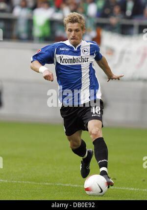 Artur Wichniarek of Bielefeld controls the ball during the Bundesliga match VfL Wolfsburg v Arminia Bielefeld at - Stock Image