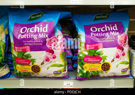 Two bags of Orchid Potting Mix in a garden centre - Stock Image