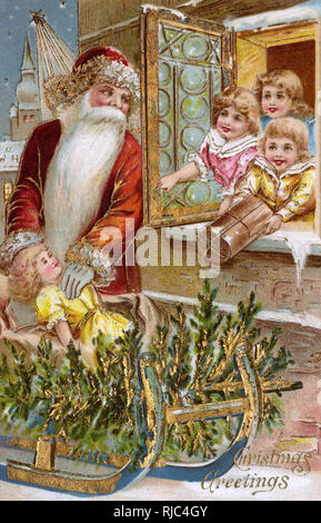 Father Christmas distributing gifts to the town children. - Stock Image