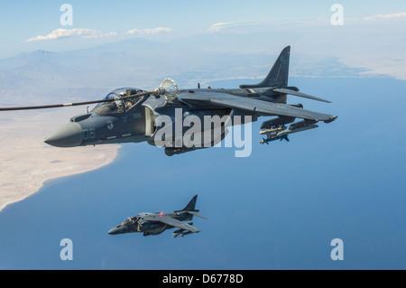 Maj. James Vallario, an AV-8B Harrier pilot with Marine Aircraft Group 13, bottom, and Maj. John Grunke, an AV-8B - Stock Image