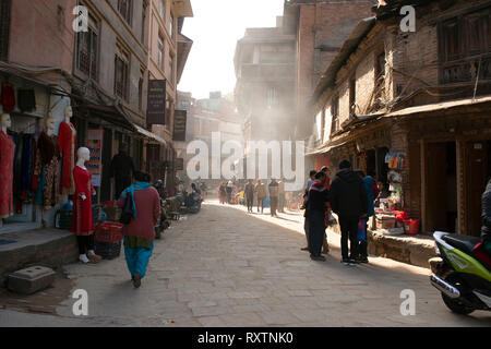 A typical street scene on a warm, sunny winter day at the UNESCO world heritage site of Bhaktapur, Nepal. - Stock Image