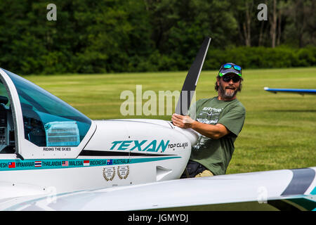 Man pulling the Texan top class touristic airplane to the runway. - Stock Image