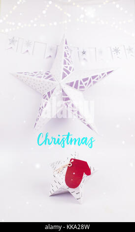 Christmas Decoration with star gift  box  with christmas star and snow garland in snow for holidays best background - Stock Image