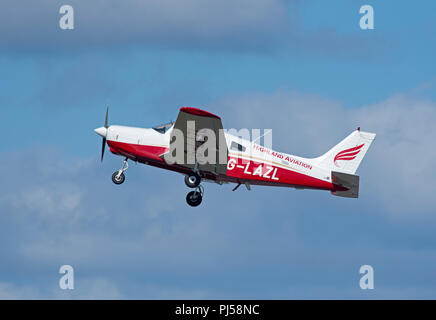 Piper PA 28-161 Warrior leaving Inverness Airport on  a local Pilot training exercise with student practising touch and go circuits - Stock Image